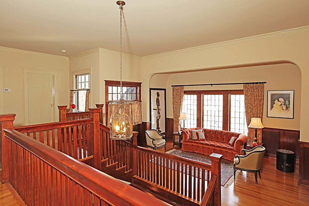 I suppose that with 7 bedrooms, 8 baths, and over 9700 square feet of living space, cleaning a house like this can be be tiring. Or just getting from one end to the other, for that matter. So, it's nice to have cozy little rest stops like this one at the head of the stairs.