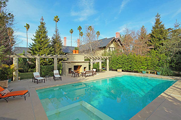 The estate rests on a double lot and overlooks expansive lawns, gardens and magnificent park-like grounds with mature trees, pond, pool and outdoor fireplace. It also features a full basement with a large wine cellar and room for a humidor.