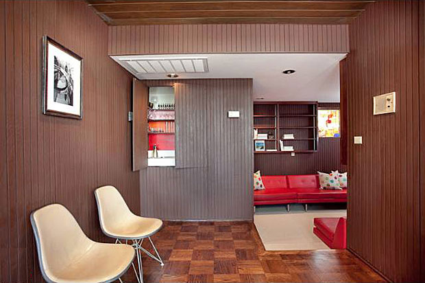 This little step-down room, which I suppose could be a library given all the shelves that line its walls, is tucked off the main living area and is fun and funky.