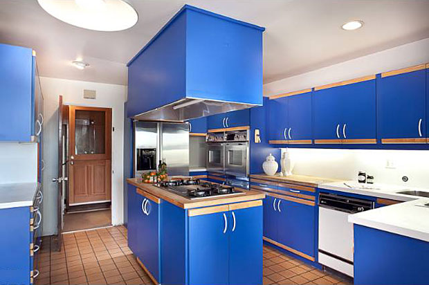 Okay, so I might change the kitchen if I lived here. Or at least wear sunglasses that neutralize its royal-blue-ness just a bit. But other than the color, it's great. A center island stove with prep area and two built-in ovens aren't super common in homes of this vintage.