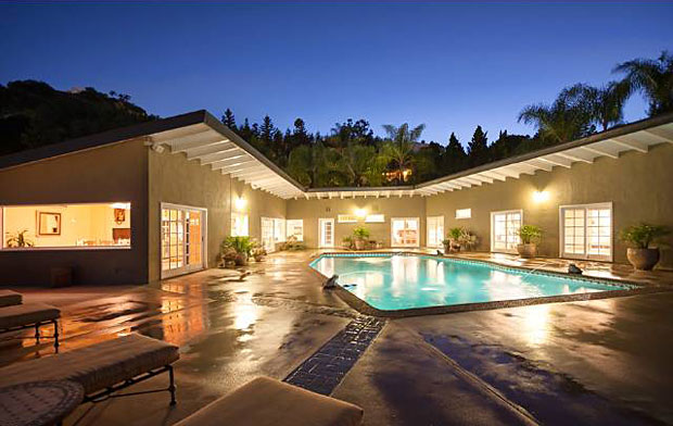 Now we get to my favorite part of the house. If you're going to have a swimming pool in the backyard, why not have every part of the house open up to it? That's just awesome.