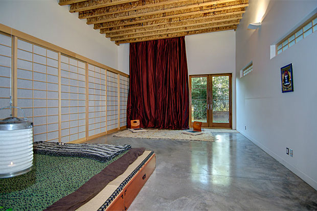 In the rear of the residence are 2 bedrooms, both of which open to a Zen backyard surrounded by mature black and timber bamboo for shade and ultimate privacy on hot summer days.