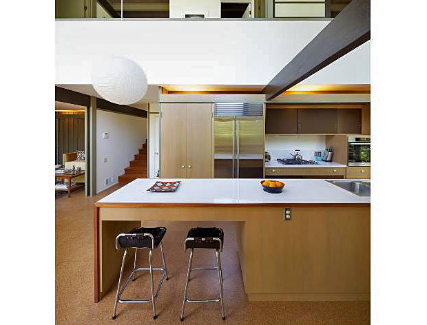 Kitchen features Sub-Zero refrigerator and Miele appliances.