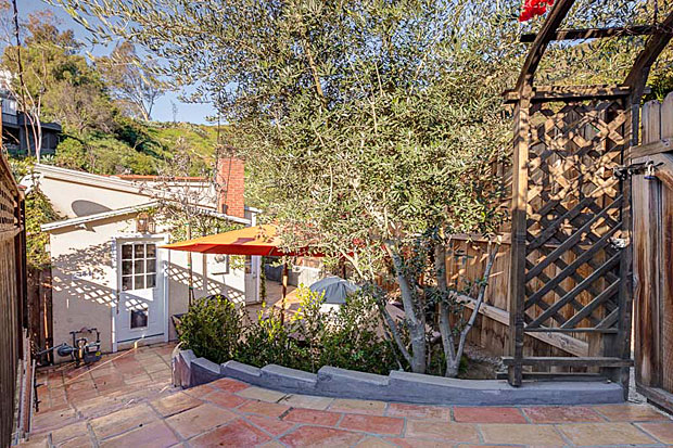 Located at the northern edge of the historically rich Hollywood Dell, this home is nestled up against a green belt with access to trails and, best of all, it's a short walk to the Hollywood Bowl. No need to deal with traffic and parking when going to a concert!