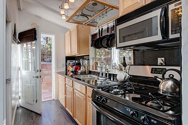 The updated kitchen, which leads to the patio, features stainless steel appliances and beautiful finishes.