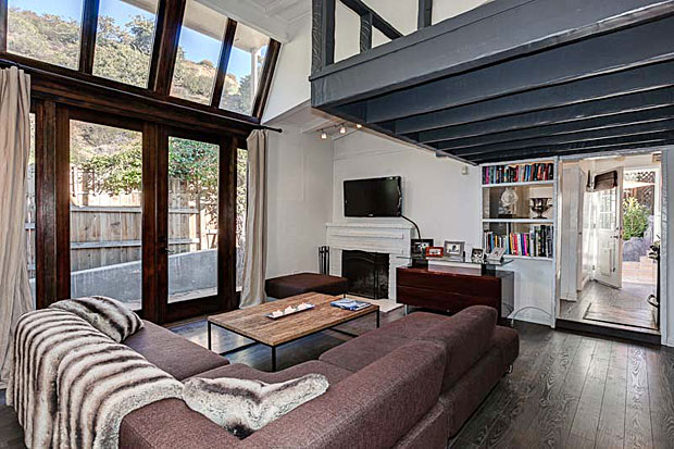 Though there is only one bedroom, the living room features a sleeping loft suspended above it thanks to the very high ceilings. And check out the floor-to-ceiling windows, including double doors that open up to the patio. It doesn't get much more light and airy than that.