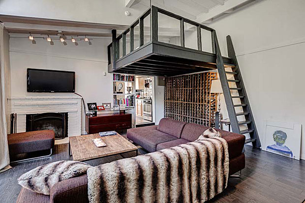 Though there is only one bedroom, the living room features a sleeping loft suspended above it thanks to the very high ceilings. And check out the floor-to-ceiling windows, including the double doors that open to the patio. It doesn't get much more light and airy than that.