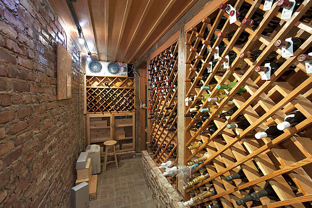 A very handsome and respectably large wine cellar. I like the way one of the walls shows some of the home's original brickwork.