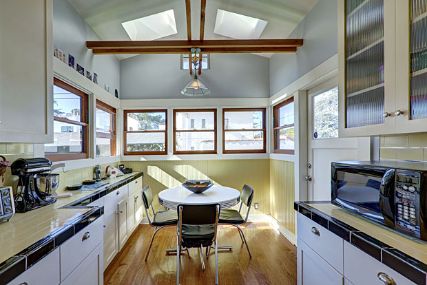 Look at this room. The light! Every kitchen should have such a cozy eating area.