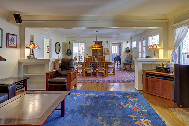 The home boasts beautiful period features including hardwood floors throughout, original moldings, Batchelder tiled fireplace and French doors off the dining room leading out to an expansive deck.