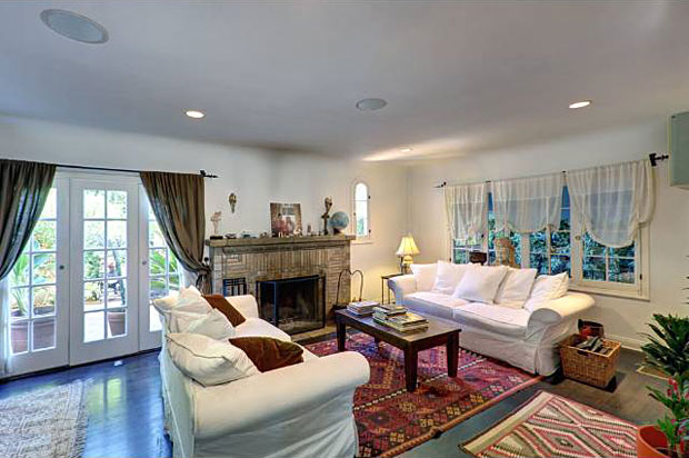 The living room includes a Batchelder tile fireplace, gorgeous hardwoods and French doors leading out to the patio. The doorways between the rooms are have a cool shape – not square, but not fully arched.
