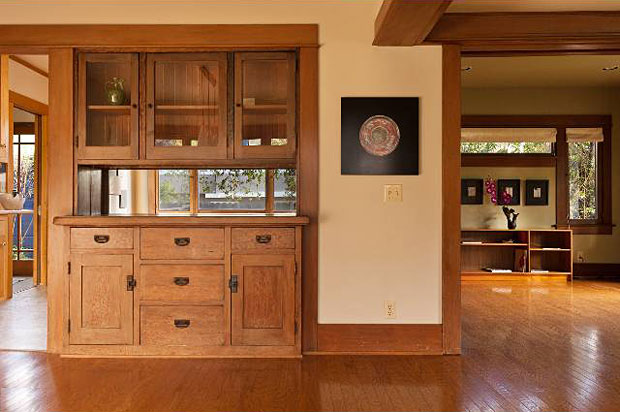 Wood equals warmth. And not just when it's burning. You gotta love these hardwood floors, trim, and built-in cabinetry,