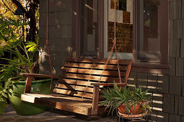 And, of course, the home features a classic front porch. In this case its appeal is further highlighted with this idyllic swinging bench seat, perfect for sipping an iced-tea on those warm Pasadena summer days.