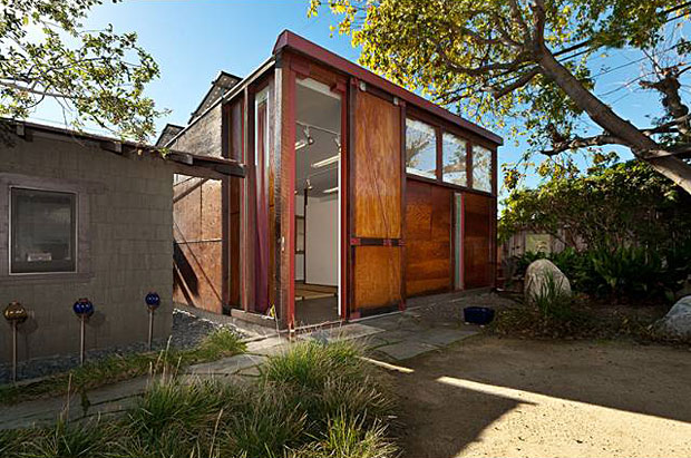 Though thoroughly modern in its design, the studio beautifully complements the century-old home beside it.
