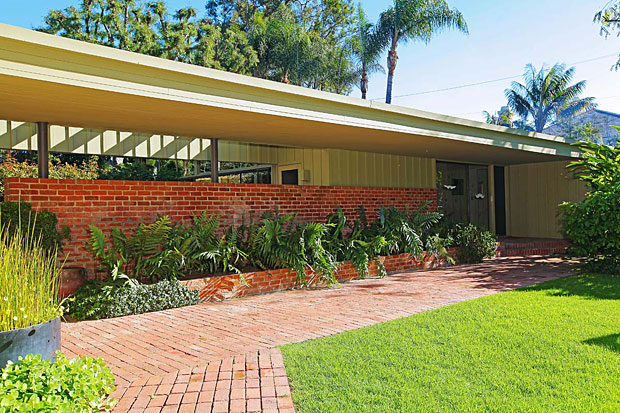 """The use of brick and redwood was an """"innovation"""" of sorts for Neutra because of a shortage of war materials during WWII. And although these materials may be considered """"rustic"""" (as compared to the sprayed concrete, for instance, that Neutra began using 1929 on the Lovell House), the rest of the design leaves no doubt that this residence is designed by a master of the International movement."""