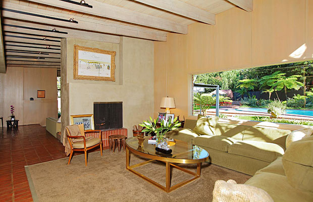 """If ever there was a """"picture window"""", this living room features it."""