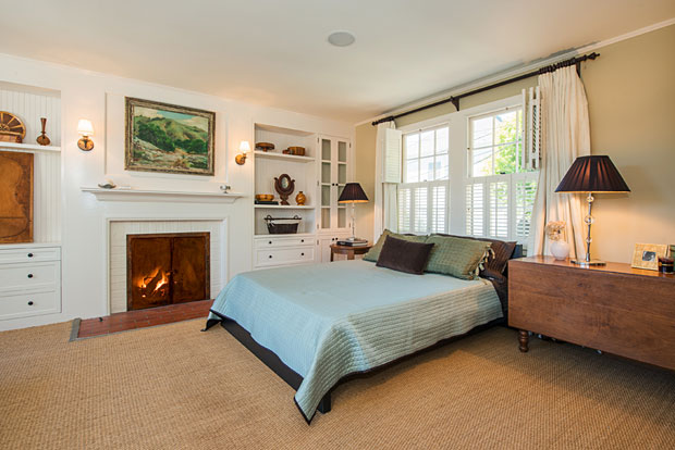 On the second floor is a spacious master suite – yet another room built-ins and a romantic fireplace.