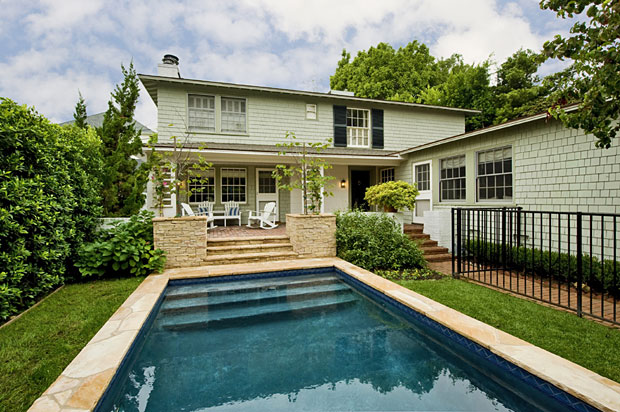 "Professionally landscaped front gardens including a quintessential ""front porch"" and charming rear dining/party patio and a new saltwater pool."