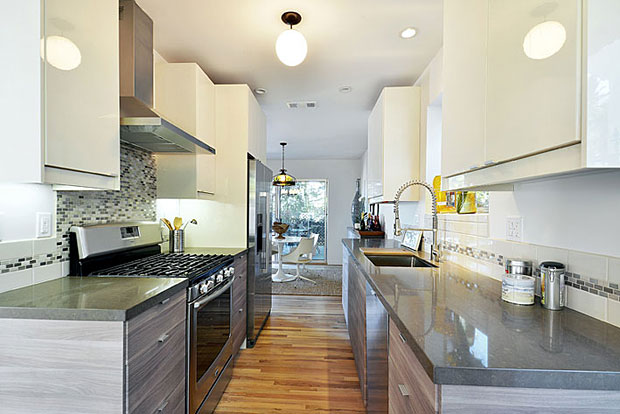 The completely updated kitchen has an ultra sleek, euro style that will surely elicit a few oohs and aahs from friends.