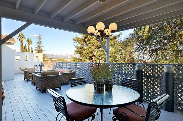 The partially covered top-floor deck features fantastic views all the way to the mountains.