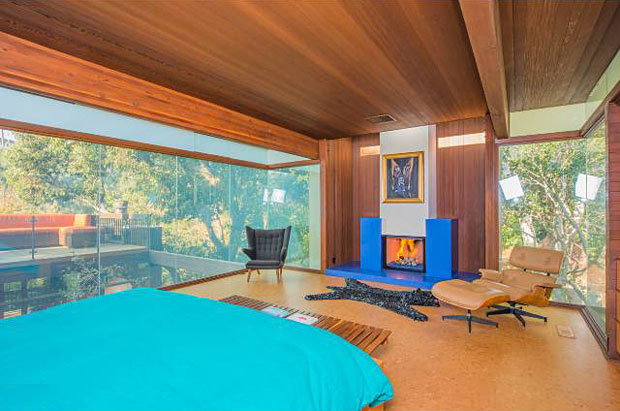 The full-floor master bedroom boasts a private rooftop deck with a fire pit and views overlooking the canyon.