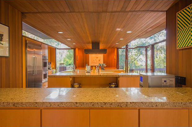 The home includes many updates, including the kitchen with modern appliances and custom made cabinetry.