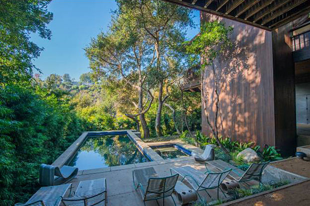 The dense tree growth covering the hills surrounding the property provides the home with loads of privacy.