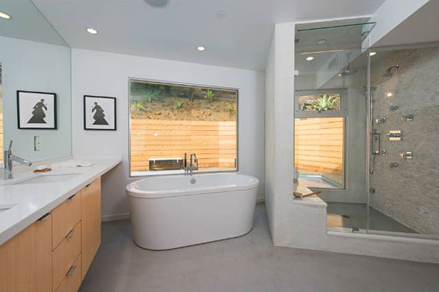 I admit that soaking tubs are nice, but steam showers rock – like this huge multi-zone unit with built-in bench seat.