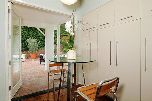 Though not an eat-in kitchen, it's large enough to accommodate a breakfast table, which is right near a large doorway to the yard and patio.
