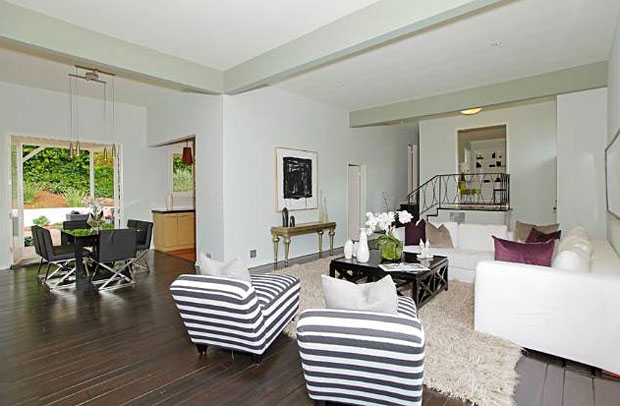 This handsome and well cared-for 1957 home nestled into the corner of Doheny and Oriole Drives features 2 bedrooms, 2 baths, and a den.