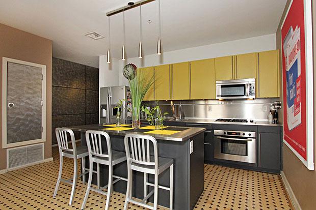 The custom Poggen Poh kitchen includes high-end Bosch appliances and vintage tile.