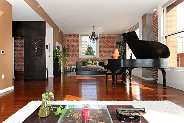 The exposed brick walls are complemented beautifully by the recently refinished Douglas Fir hardwood floors.
