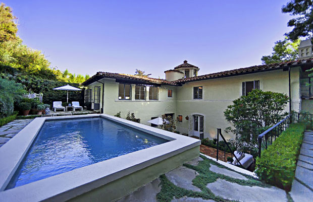 At the second level of the backyard is this beautiful pool and a terrace.