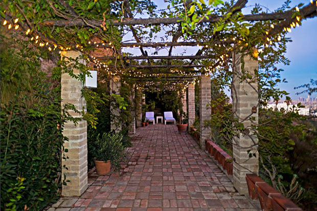 On the uppermost level of the back yard is a long pergola with that sits high above the house and commands unobstructed views of the city and beyond.