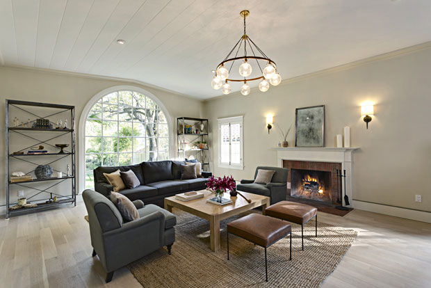 If one Great Room isn't enough, this original living room has an equal amount of grandeur with matching arched window and a wood-burning fireplace.