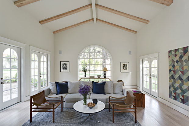"""A """"Great Room"""" should be just that, and this one is. From its size, which measures 495 square feet, to its 16' wood-beamed ceilings, large arched window and French doors, this room imparts an airy grandeur that you'll love."""