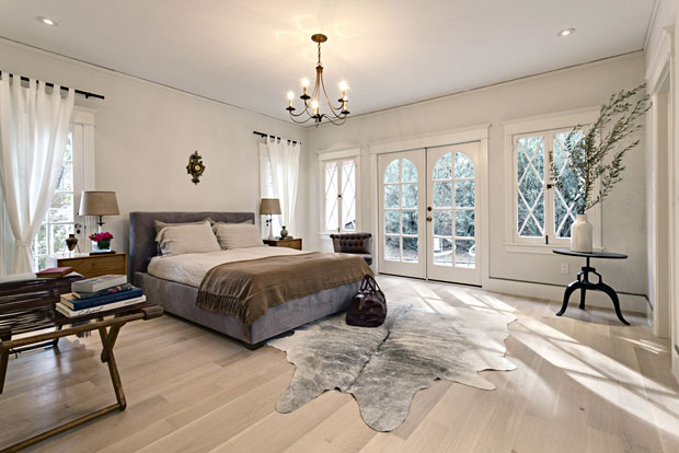 Most rooms, including the master bedroom, open to the beautifully landscaped park-like grounds.