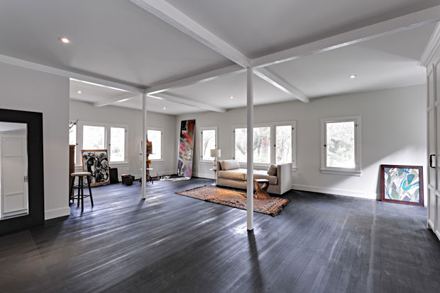 The guest suite has a loft feel to it and would make an awesome studio space.