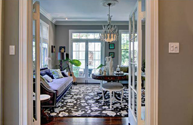 Cozy adjoining family room with French doors open to the rear veranda.