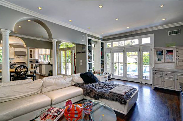 The spacious living room with fireplace and formal dining room are surrounded by beautifully landscaped grounds. Some of the home's rich features are high ceilings, dark wood floors and crown moldings throughout.