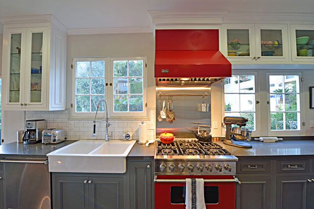 This brand new kitchen is superb. It features Caesarstone and honed Carrara marble counters and top-of-the-line appliances. I particularly dig the fire engine red commercial-style stove.