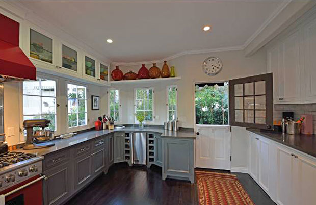 he curve of the cabinetry and counter space at the end of the kitchen is another feature that I love. It's one of those simple design elements that is perfectly suited for its space and the kind of thing that you'll find yourself loving as you make use of it every day.