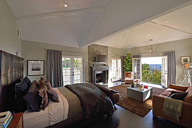 With its large French door windows and a fireplace for chilly nights, this huge master suite is a dream.