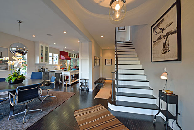 As you enter the home, you face a staircase leading to the second floor and, to the left, an open-flowing dining room and kitchen area. It's a bit of an uncommon layout, but I really like it.