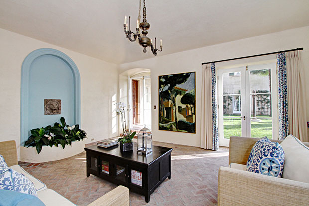 This comfy garden room/family room has French doors that open up to an intimate garden.