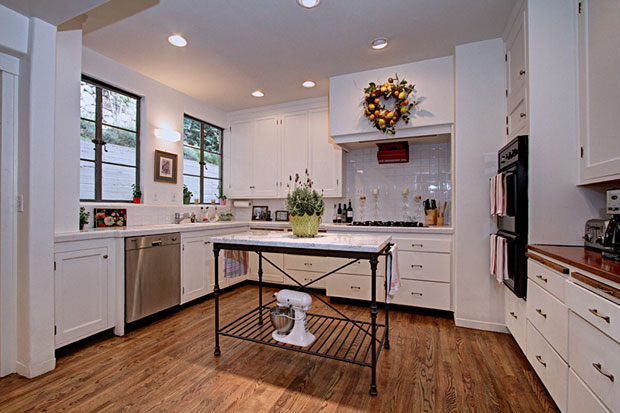 The kitchen features a very large butler's pantry on one wing (below) and as well as an adjoining breakfast area.