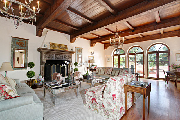To say the attributes of this home are impressive is an understatement. The living room features teak hardwood flooring, a hand-hewn wood beam ceiling, a cast stone fireplace and an adjacent card room.