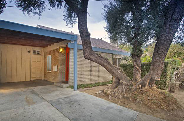 """The listing describes the property as 'adobe style meets NY writers/artist loft style home', which I think is a great characterization. From the outside, it's quietly unpretentious. The walls are made of slump stone, a brick that was the choice of many a Spanish builder for Missions in the Southwest. But inside, the design was intended to be open, functional and """"modern""""."""