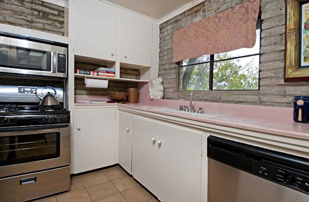 A kitchen still lives in a very 50's pink.