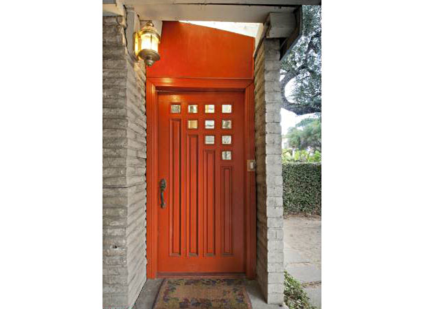 The front door of the home's original design opened directly into the living room. A foyer was later added, which, combined with this cool door adds a degree of panache to the house.